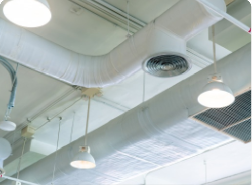 ceiling with pipes, vents and hanging lights