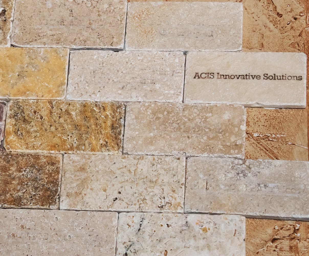 Marbled bricks with ACIS Innovation Solutions text
